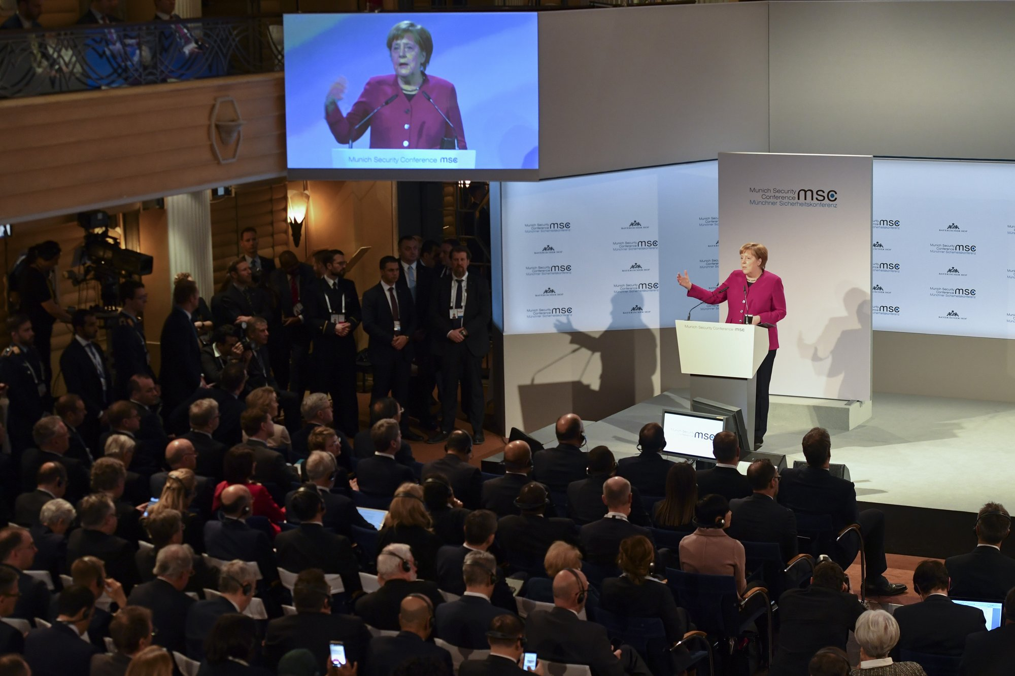 Merkel defends Iran deal, multilateralism but Pence resists