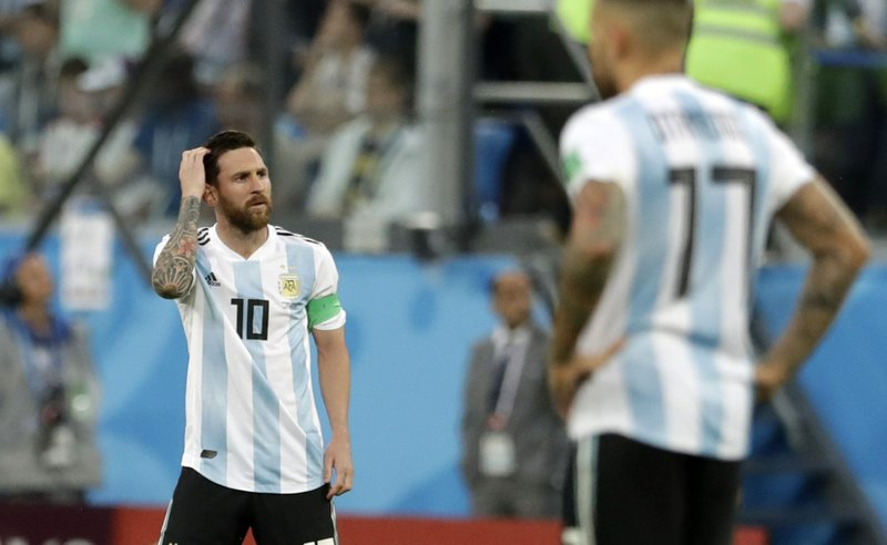 Argentina's Lionel Messi reacts after the opening goal of Nigeria during the group D match between Argentina and Nigeria, at the 2018 soccer World Cup in the St. Petersburg Stadium in St. Petersburg, Russia, Tuesday, June 26, 2018.