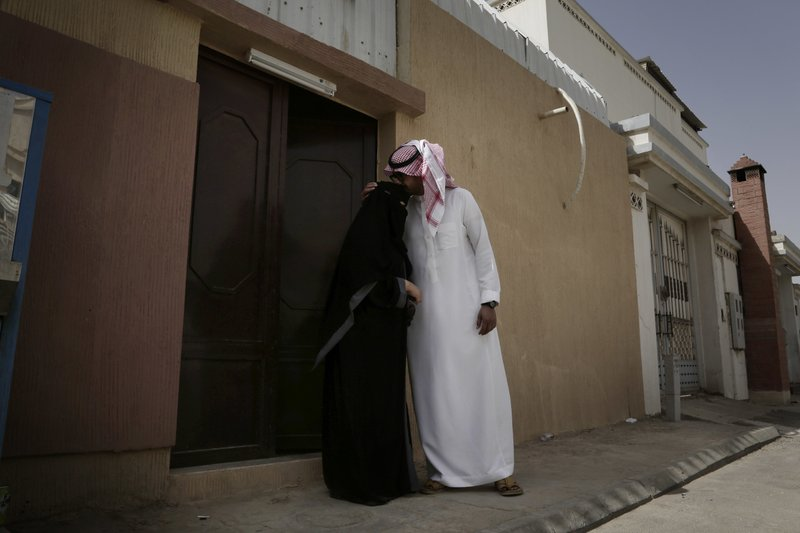 The brother of 27-year old Mabkhoutahal-Mari kisses her forehead before she drives to work for the first time in Riyadh, Saudi Arabia, Sunday, June 24, 2018. Saudi women are in the driver's seat for the first time in their country and steering their way through busy city streets just minutes after the world's last remaining ban on women driving was lifted on Sunday.