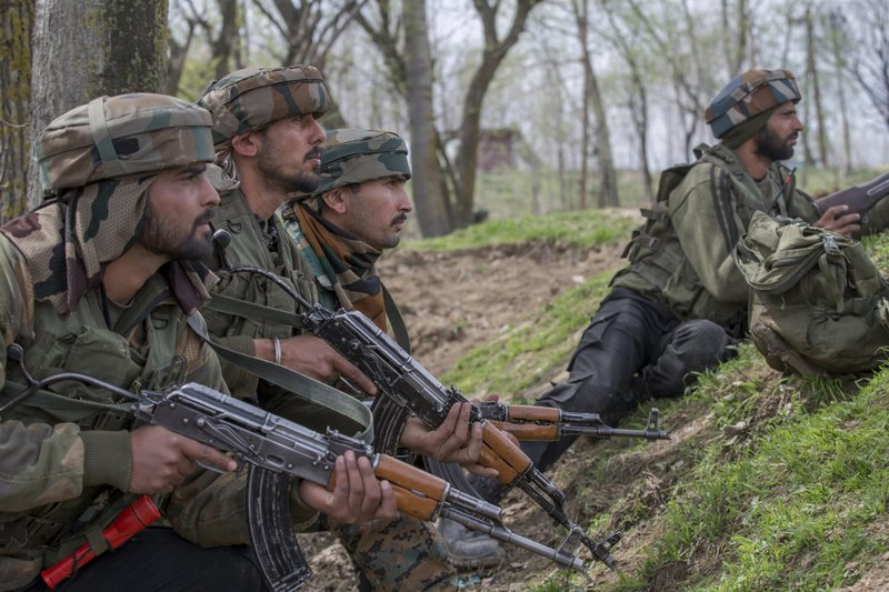 Indian army soldiers take position near the site of gun battle in Chadoora town, about 25 kilometers (15 miles) south of Srinagar, Indian controlled Kashmir, Tuesday, March 28, 2017. The gunbattle began after police and soldiers cordoned off the southern town of Chadoora following a tip that at least one militant was hiding in a house, said Inspector-General Syed Javaid Mujtaba Gillani. As the fighting raged, hundreds of residents chanting anti-India slogans marched near the area in an attempt to help the trapped rebel escape.