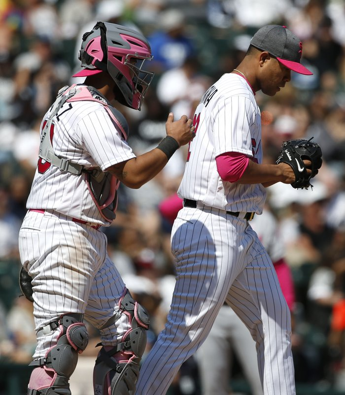 White Sox catcher Omar Narvaez, left, talks to starting pitcher Jose Quintana during the seventh inning of an interleague baseball game against the San Diego Padres in Chicago, Sunday, May 14, 2017. (AP Photo/Nam Y. Huh)