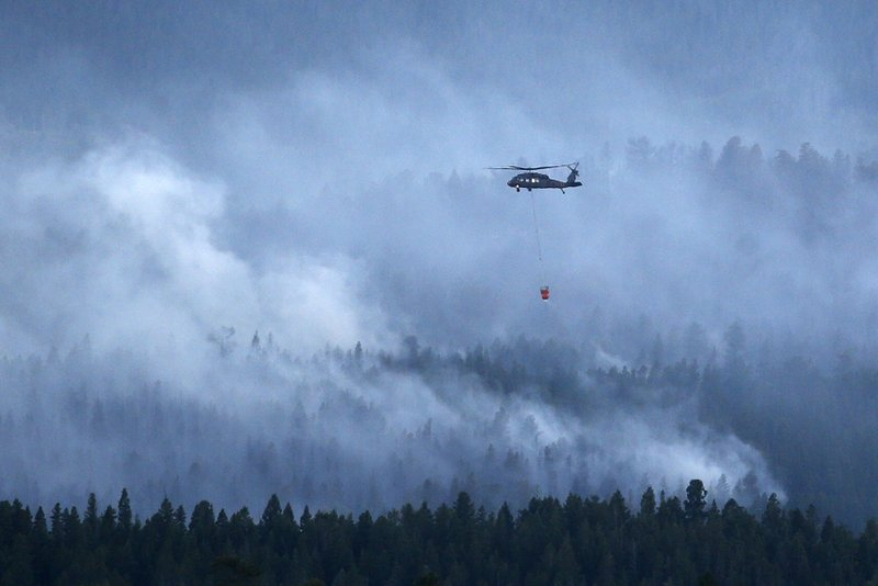 Firefighters work to stop spread of wildfire near Nederland