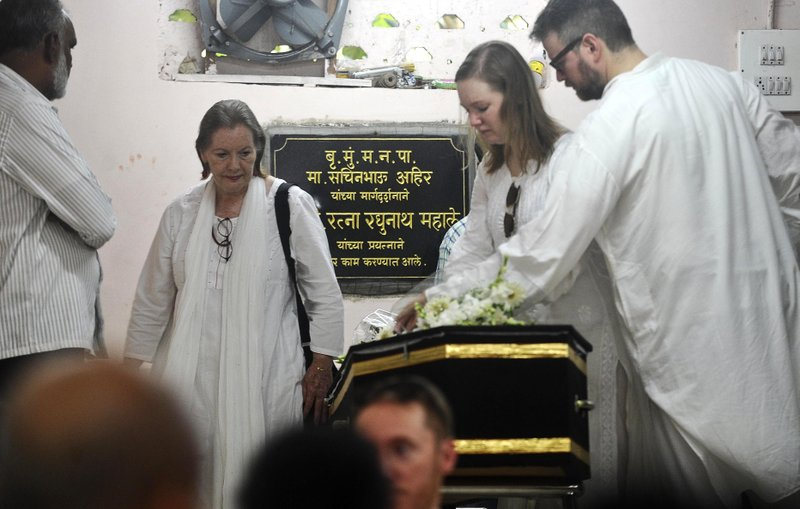Carole Evans Alter, second left, walks by the coffin of her husband Tom Alter in Mumbai, India, Saturday, Sept. 30, 2017. Tom Alter, a well-known Indian theater, television and Bollywood actor of American descent, has died in Mumbai of cancer. He was 67. Alter was the son of American Christian missionaries.