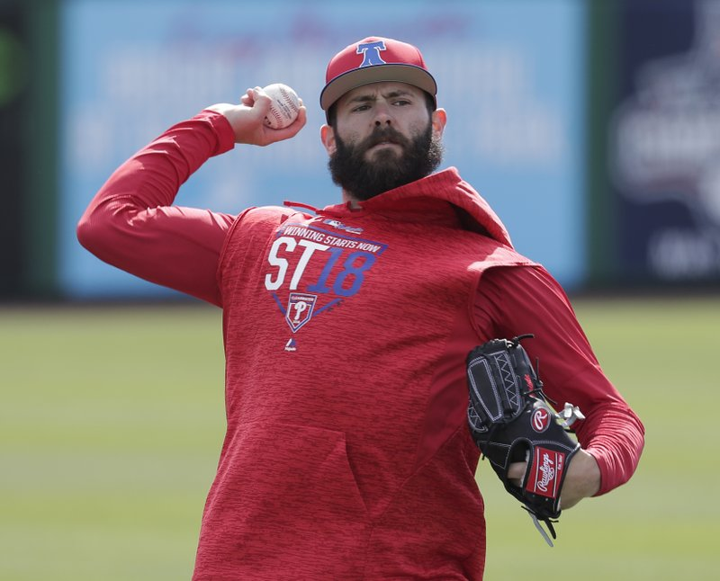 6e6301f6e6a Philadelphia Phillies pitcher Jake Arrieta throws during a work out before  a spring baseball exhibition game against the Tampa Bay Rays