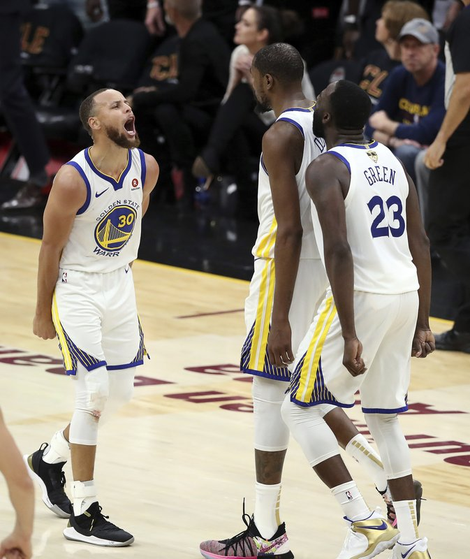 brand new 271d3 d28cc Golden State Warriors  Kevin Durant celebrates with Stephen Curry, left,  and Draymond Green (23) during the second half of Game 3 of basketball s  NBA Finals ...