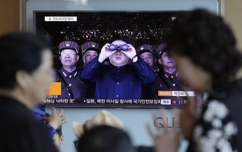 In this Sunday, May 14, 2017, photo, a TV news program shows a file image of North Korean leader Kim Jong Un at Seoul Railway Station in Seoul, South Korea. North Korea on Sunday test-launched a ballistic missile that landed in the Sea of Japan, the South Korean, Japanese and U.S. militaries said. The launch is a direct challenge to the new South Korean president elected four days ago and comes as U.S., Japanese and European navies gather for joint war games in the Pacific.