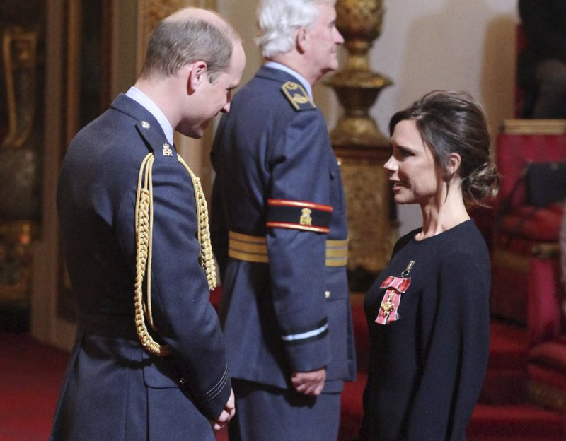 Posh Day At Palace Victoria Beckham Gets Royal Recognition