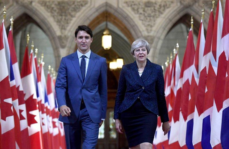 Theresa May Justin Trudeau