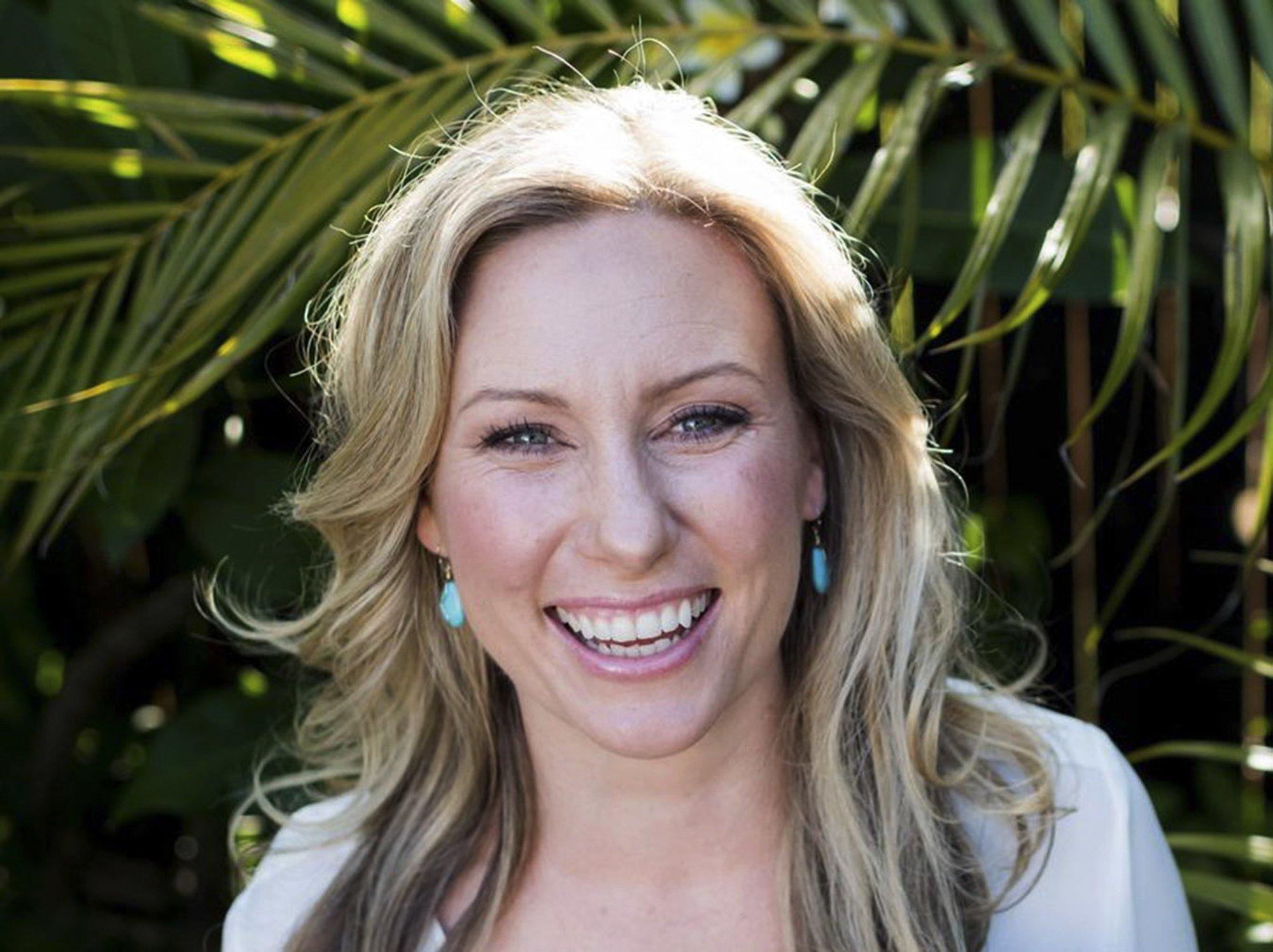 Officials: Australian woman shot after cops heard loud sound