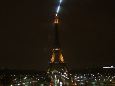 Raw: Eiffel Tower Goes Dark for Canada