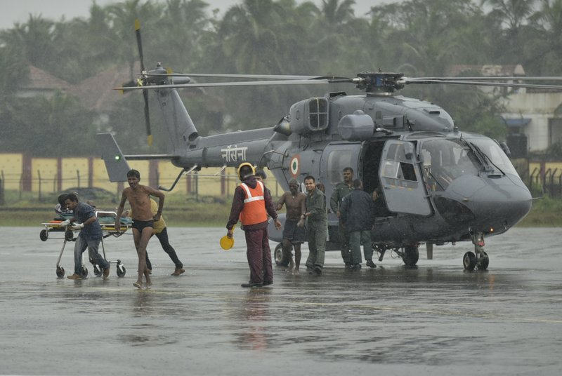 Indian fishermen who were stranded in the Arabian Sea get down from an Indian Navy helicopter after they were rescued in Thiruvananthapuram, Kerala state, India, Friday, Dec.1, 2017. Dozens of fishermen were rescued from the sea which is very rough under the influence of Cyclone Ockhi.