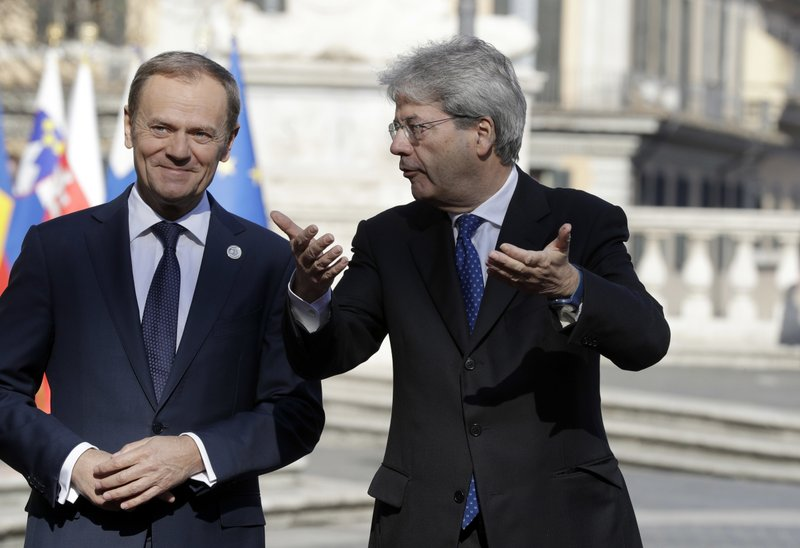 Italian Prime Minister Paolo Gentiloni, right, speaks with European Council President Donald Tusk during arrivals for an EU summit at the Palazzo dei Conservatori in Rome on Saturday, March 25, 2017. EU leaders gather in Rome on Saturday to celebrate the 60th anniversary of the EU's founding treaty.