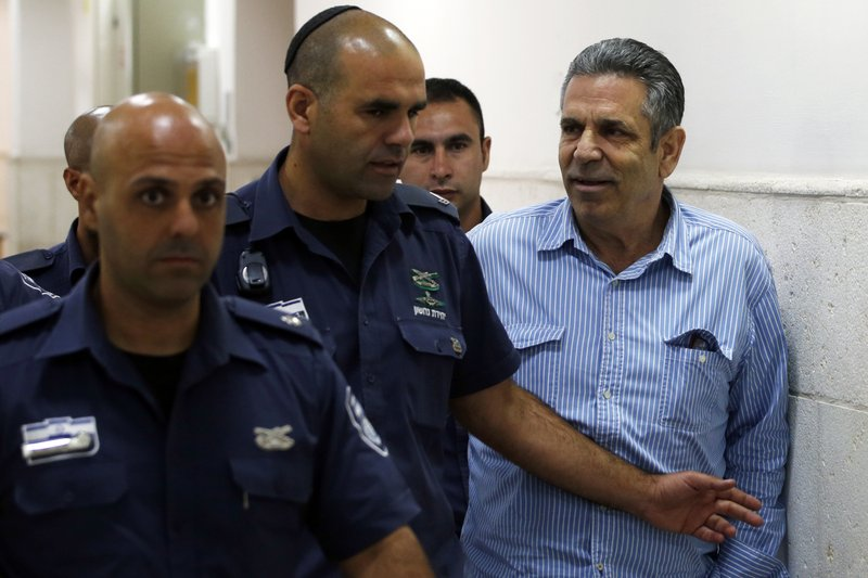 Gonen Segev, a former Israeli cabinet minister indicted on suspicion of spying for Iran, is escorted by prison guards as he arrives to court in Jerusalem