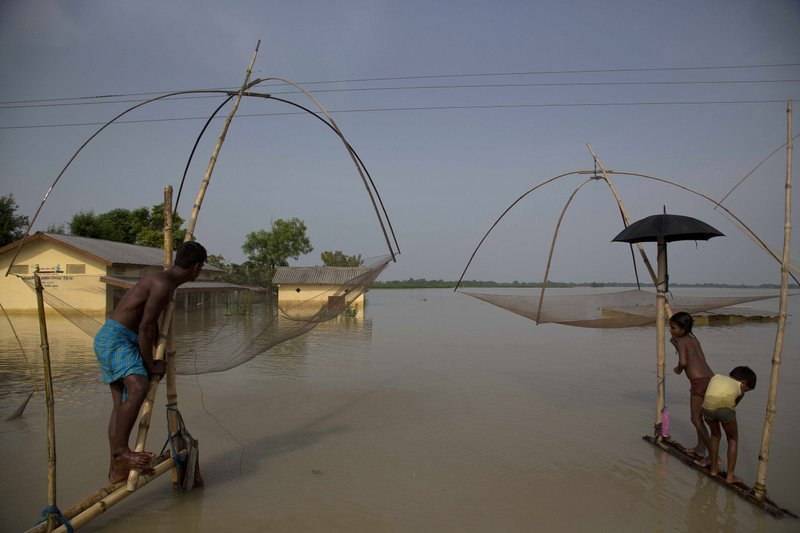 Villagers fish in floodwaters in Morigaon district, east of Gauhati, northeastern state of Assam, Tuesday, Aug. 15, 2017. Deadly landslides and flooding are common across South Asia during the summer monsoon season that stretches from June to September.