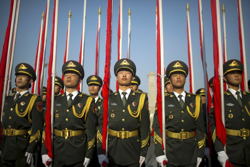In this Wednesday, May 17, 2017, photo, members of the Chinese honor guard stand in formation before a welcome ceremony for Argentina's President Mauricio Macri at the Great Hall of the People in Beijing.