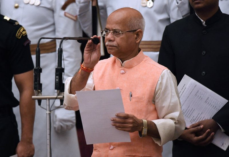 Member of parliament Shiv Pratap Shukla takes the oath during the swearing-in ceremony of new ministers at the Presidential Palace in New Delhi, India, Sunday, Sept.3, 2017. India Prime Minister Narendra Modi, on Sunday reshuffled some of his key minister's portfolios to refurbish his government's image, which has been dented by falling economic indicators.