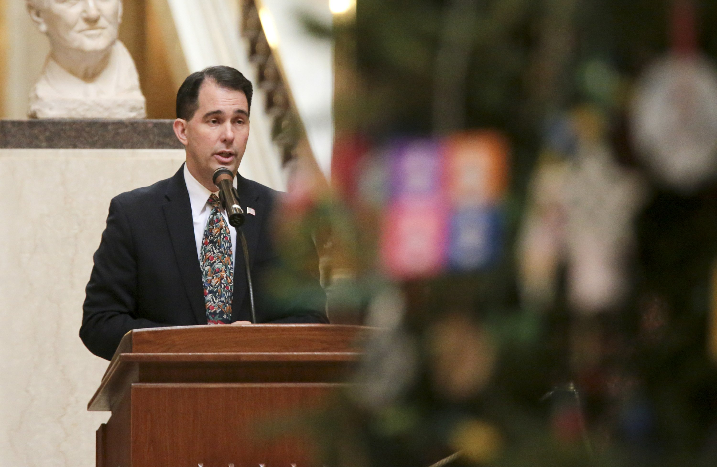 The Latest: Wisconsin Senate limits governor's power