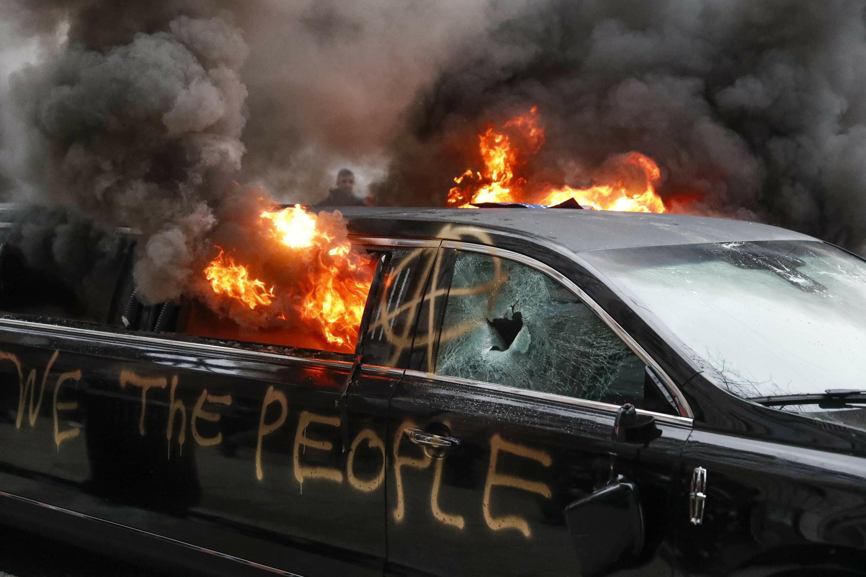 Fires, bricks mark daylong assault on inaugural festivities