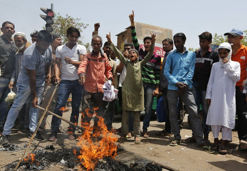 Indian burn an effigy of Pakistan and shout anti-Pakistan slogans during a protest in Ahmadabad, India, Wednesday, May 3, 2017. Two Indian soldiers were killed and their bodies mutilated Monday in an ambush by Pakistani soldiers along the highly militarized de facto border that divides the disputed region of Kashmir between the nuclear-armed rivals, the Indian army said. But Pakistan denied any such attack, calling the Indian claims false.