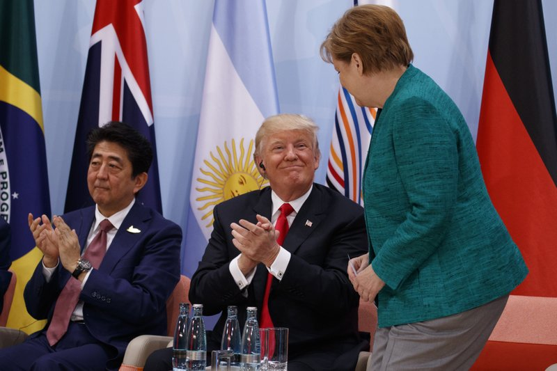 Donald Trump, Shinzo Abe, Angela Merkel