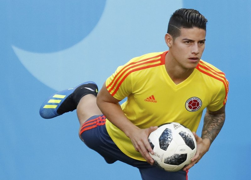 Colombia's James Rodriguez warms up during Colombia's official training on the eve of the group H match between Colombia and Japan at the 2018 soccer World Cup in the Mordavia Arena in Saransk, Russia, Monday, June 18, 2018.