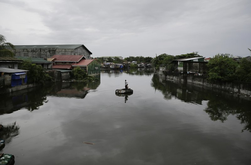 Residents pull a rope in an improvised raft to cross a swollen river caused by tropical storm Gorio on the outskirts of Manila, Philippines on Wednesday, July 26, 2017. Strong rains caused floods in low-lying areas and classes were suspended in most schools in the capital due to bad weather.