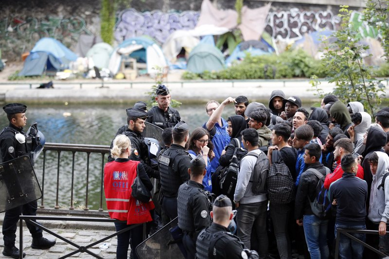 French Gendarmes And Associations Members Count Migrants As They Are  Clearing Out A Makeshift Camp Along Side Of The Canal Saint Martin, In  Central Paris, ...