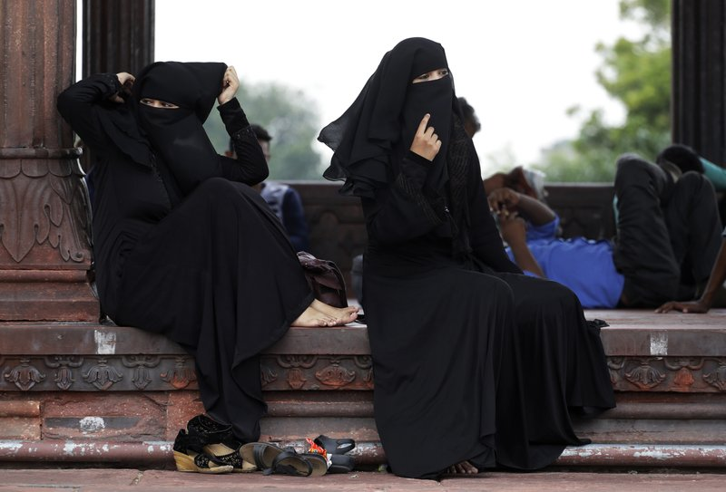 Indian Muslim women rest inside Jama Masjid in New Delhi, India, Tuesday, Aug. 22, 2017. India's Supreme Court on Tuesday struck down the triple talaq Muslim practice that allows men to instantly divorce their wives as unconstitutional.
