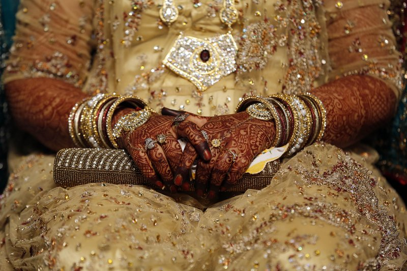 In this May 11, 2014 file photo, an Indian Muslim bride sits during a mass marriage where thirty-five couple got married in Mumbai, India. India's Supreme Court said Tuesday, Aug.22, 2017 that the Muslim practice that allows men to instantly divorce their wives is unconstitutional and requested the government legislate an end to the practice.