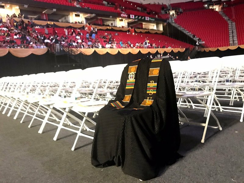 Graduation day bittersweet for slain black scholar's friends