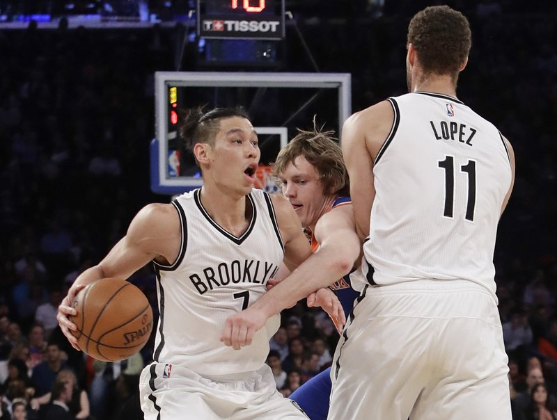 2b4d4189d849 Brooklyn Nets  Jeremy Lin (7) uses a pick set by Brook Lopez (11) as New  York Knicks  Ron Baker defends during the second half of an NBA basketball  game ...