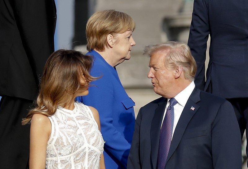 Donald Trump, Melania Trump, Angela Merkel