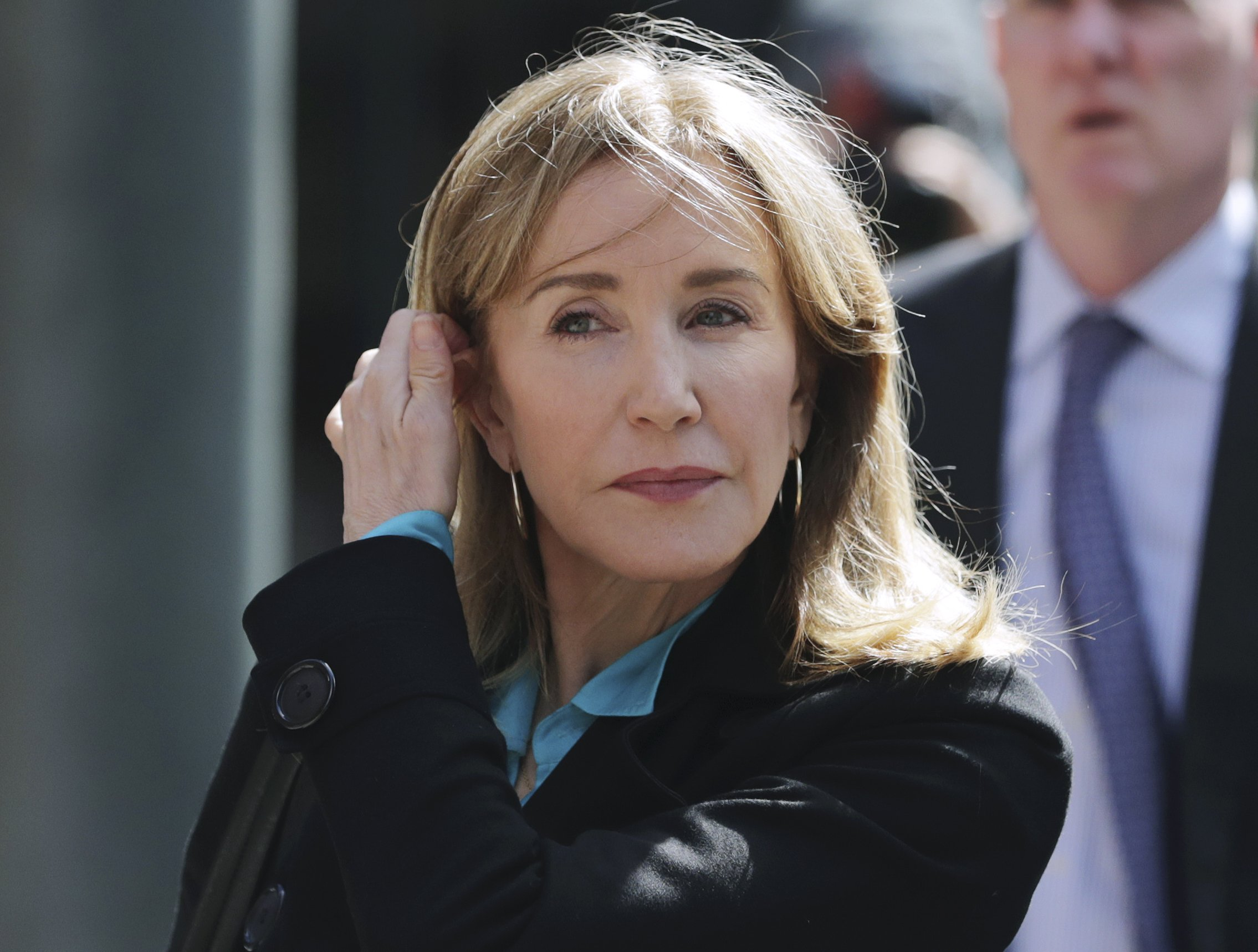 Felicity Huffman to plead guilty in college admissions scam