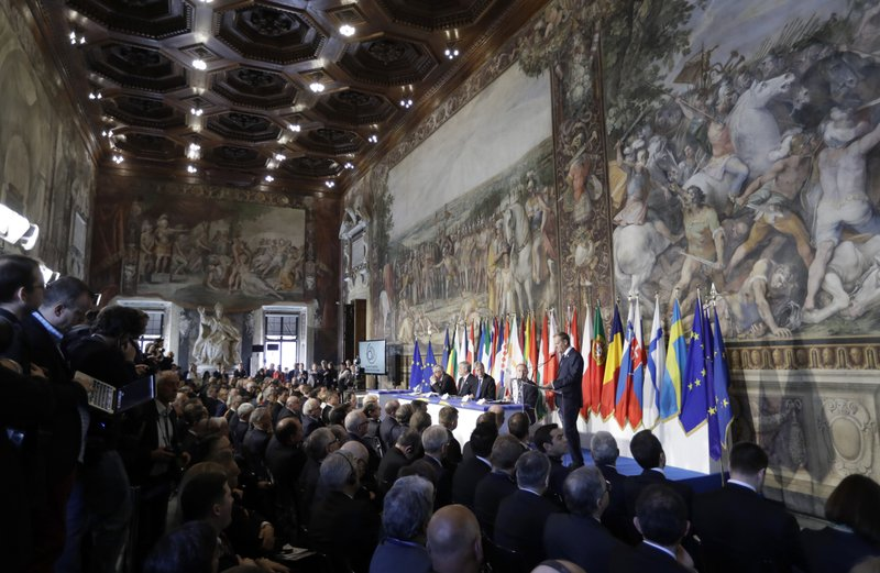 European Council President Donald Tusk, panel right, speaks to EU leaders during an EU summit meeting at the Orazi and Curiazi Hall in the Palazzo dei Conservatori in Rome on Saturday, March 25, 2017. European Union leaders were gathering in Rome to mark the 60th anniversary of their founding treaty and chart a way ahead following the decision of Britain to leave the 28-nation bloc.