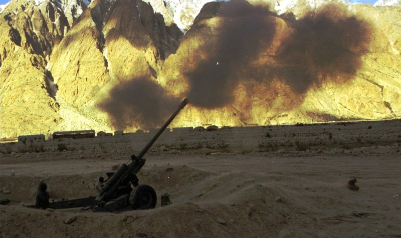 In this June 11, 1998 file photo, Indian soldiers fire artillery shells on Pakistani posts in Siachen glacier sector about 404 miles (650kms) north of the Kashmir city of Srinagar. Firing in Siachen increased after India and Pakistan conducted nuclear tests the previous month. As the 70th anniversary of India-Pakistan Partition comes up next week, relations between the two nations are as broken as ever. In some ways, their violent birth pangs dictated their future course through suspicion and animosity.