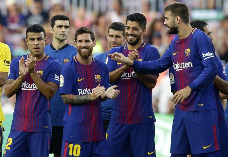 Lionel Messi, Gerard Pique, Luis Suarez