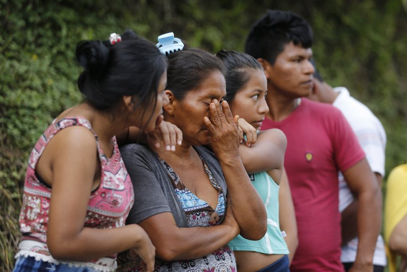 "People line up outside a cemetery to looking for their missing relatives in Mocoa, Colombia, Sunday, April 2, 2017. Colombia's President Juan Manuel Santos, who has declared Mocoa a disaster area, said that at least 207 were killed but that the death toll was changing ""every moment."" Authorities said another 200 people, many of them children, were injured and just as many were unaccounted for amid the destruction."