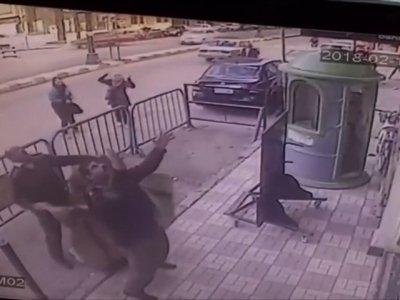 Egyptian policemen catch child falling off 3rd floor