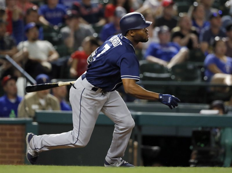 San Diego Padres' Manuel Margot watches his RBI sacrifice fly out off Texas Rangers' Martin Perez during the seventh inning of a baseball game, Thursday, May 11, 2017, in Arlington, Texas. (AP Photo/Tony Gutierrez)