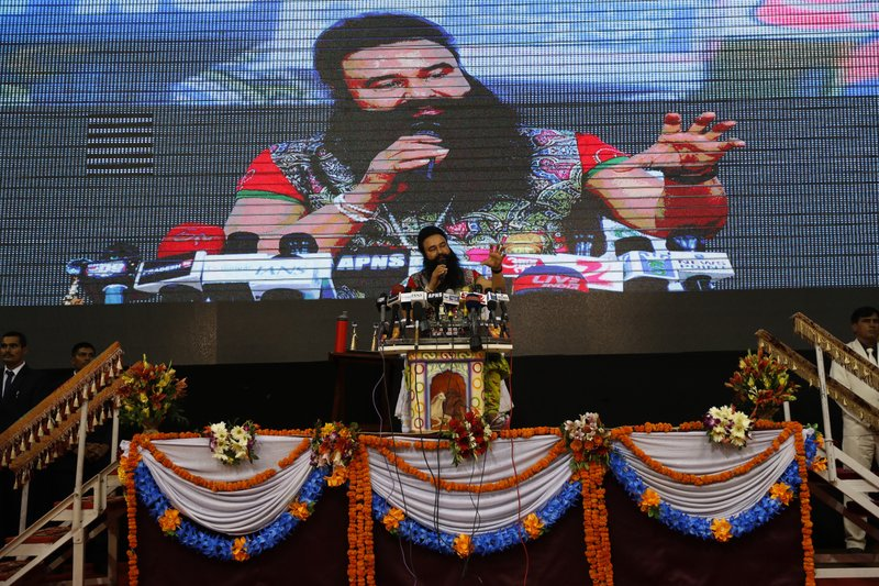 In this Oct. 5, 2016, photo, an Indian guru, who calls himself Dr. Saint Gurmeet Singh Ram Rahim Insan, addresses a press conference ahead of releasing his new movie, MSG The Warrior, Lion Heart in New Delhi, India. A judge on Monday, Aug. 28, 2017, sentenced the flamboyant and controversial Indian spiritual guru to prison on charges of raping two female followers.