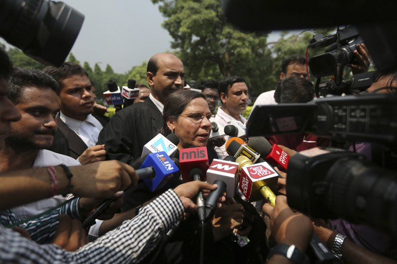 "Farha Faiz, a Supreme Court lawyer, speaks to media after the apex court declared ""Triple Talaq"", a Muslim practice that allows men to instantly divorce their wives, unconstitutional in its verdict, in New Delhi, India, Tuesday, Aug. 22, 2017. The court also requested the government legislate an end to the practice."