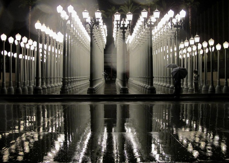 18 2010 File Photo Chris Burden S Sculpture Urban Light A Collection Of Street Lights From Many Eras Is Reflected In The Rain At Los Angeles