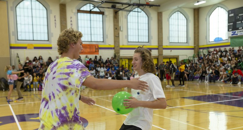 Students participate in first day of school assembly at East High School