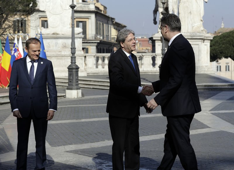 Italian Prime Minister Paolo Gentiloni, center, shakes hands with Croatian Prime Minister Andrej Plenkovic, right, during arrivals for an EU summit at the Palazzo dei Conservatori in Rome on Saturday, March 25, 2017. EU leaders gather in Rome on Saturday to celebrate the 60th anniversary of the EU's founding treaty.