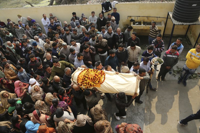 Relatives carry the body of Indian civilian Gopal Dass who was killed in Pakistani firing and shelling, during his cremation at Jhiri village in Kanachack district of Jammu and Kashmir, India, Monday, Jan.22,2018. Officials say Indian and Pakistani soldiers have again targeted each other's posts and villages along their volatile frontier in disputed Kashmir after a day's lull, killing at least one civilian.