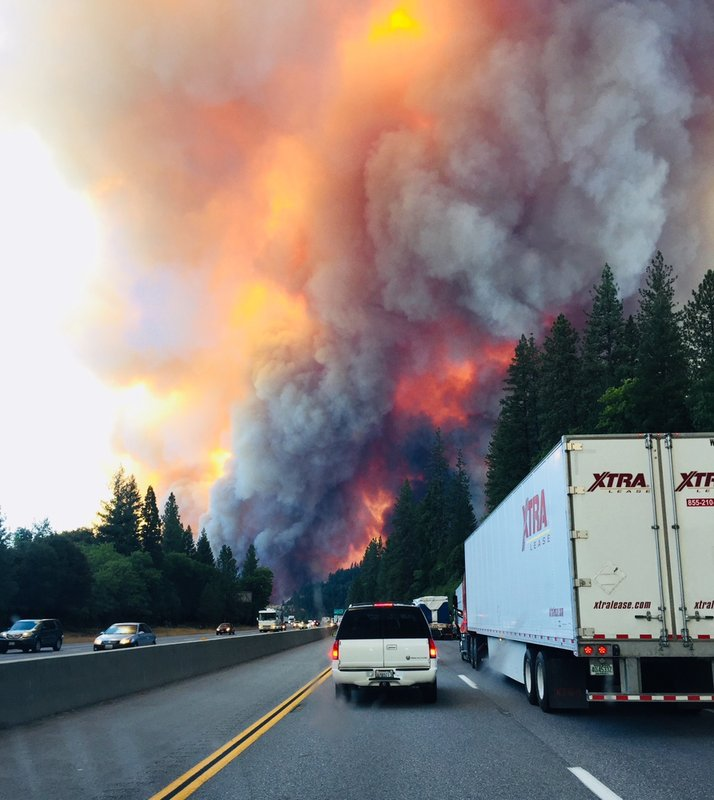 Northern California wildfire triples in size, destroys multiple big rigs