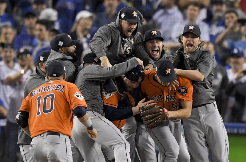 5cf7462ab7f Astros win 1st World Series crown