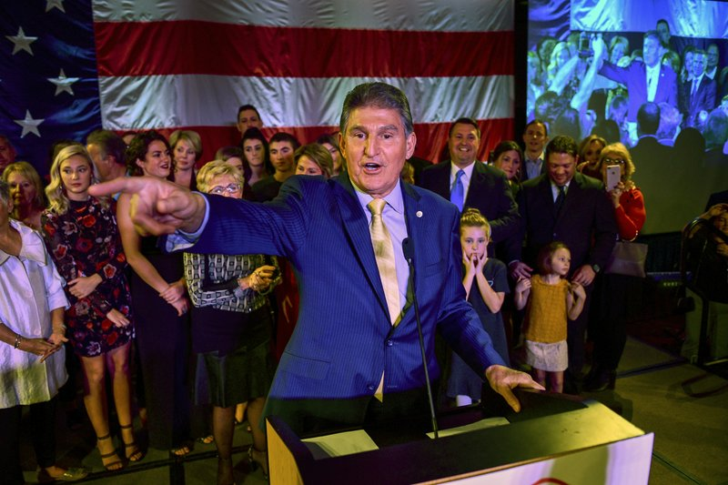 Manchin re-elected, urges Trump to stop 'toxic' talk