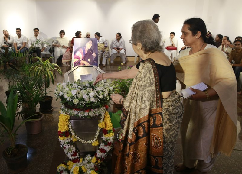 Elderly Indian women pays their last respects to classical Indian musician Kishori Amonkar in Mumbai, India, Tuesday, April 4, 2017. Amonkar, renowned for her innovative interpretation of classical Indian music, has died, one of her students said Tuesday. She was 84.