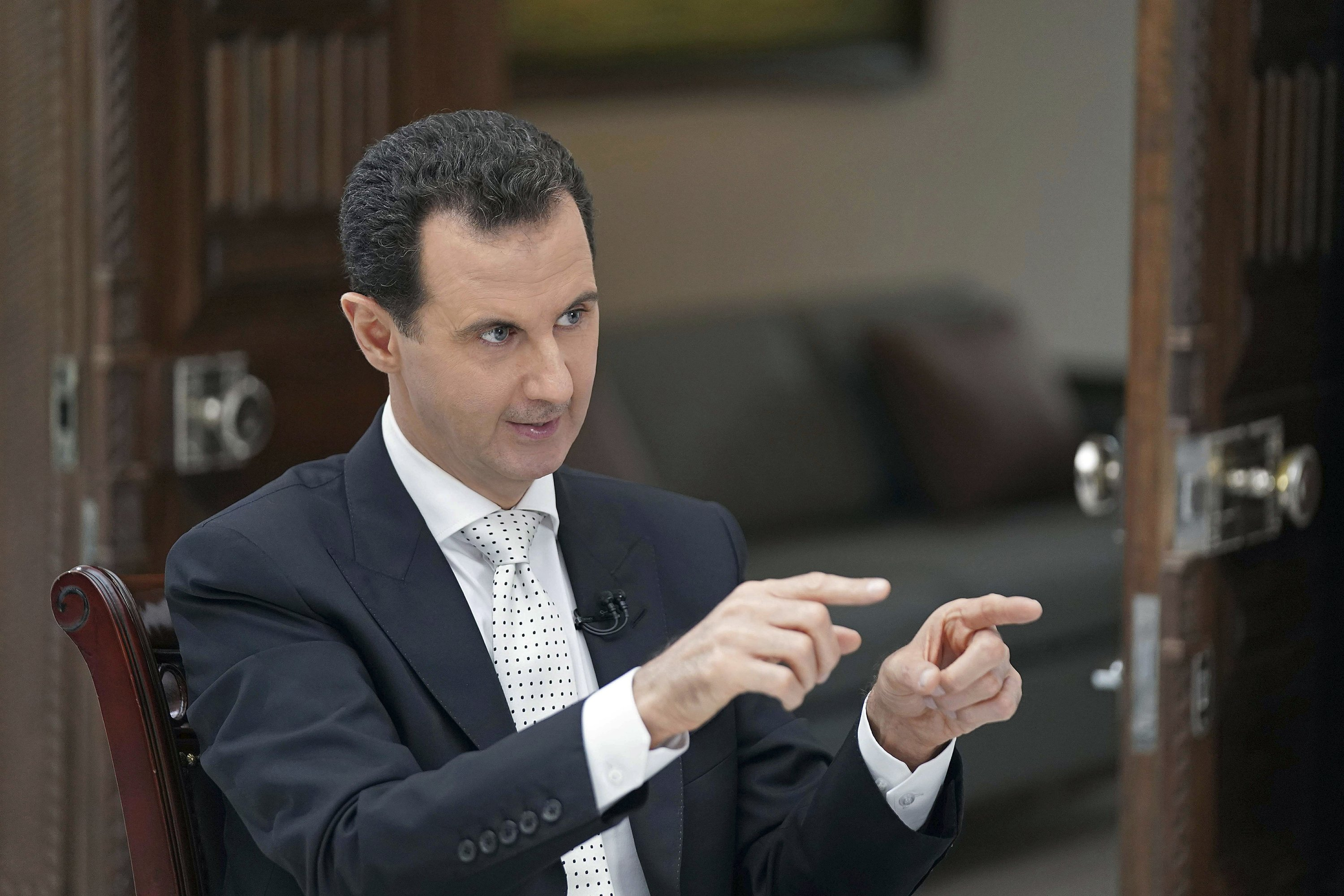 Syria's Assad threatens to attack area under US-backed Kurds